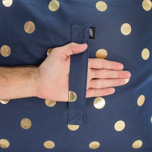 Close up of the handle on the navy blue metallic gold coin dot print