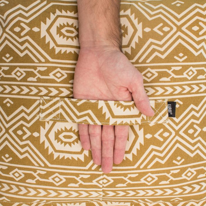 Close up of the handle on the mustard tan yellow ottoman with geometric aztec tribal print