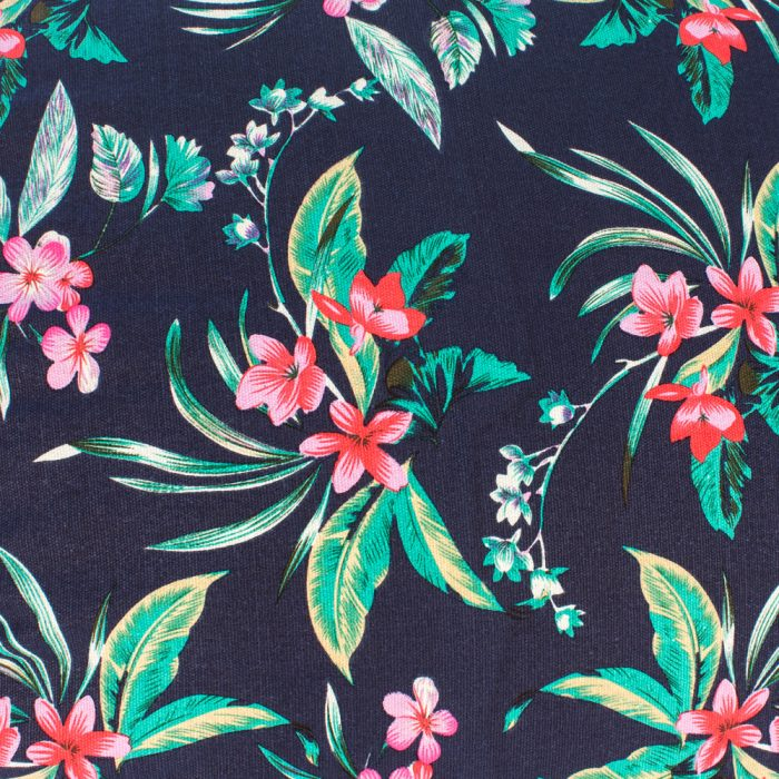 Close up of tropical print fabric with pink orange flowers on a navy background