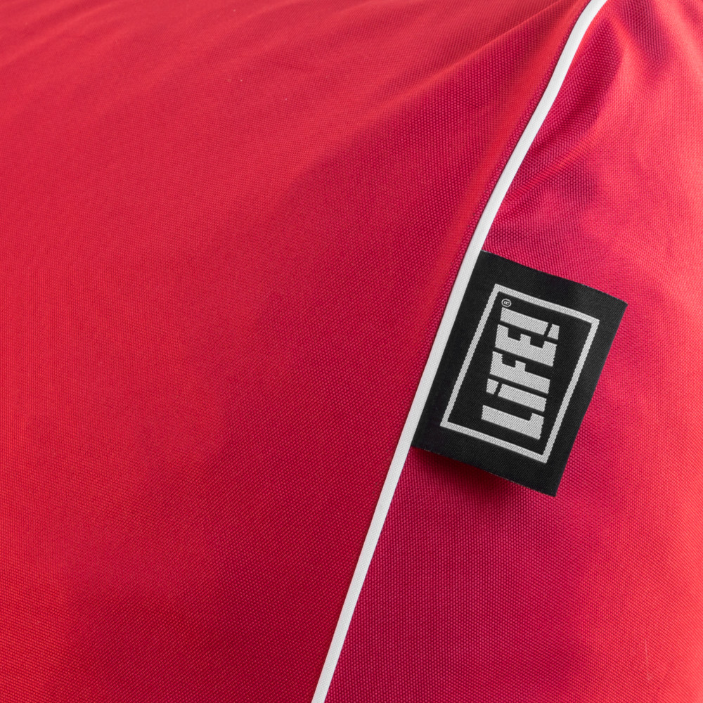 Close up of the life! logo and tag on the red coastal lounge bean bag