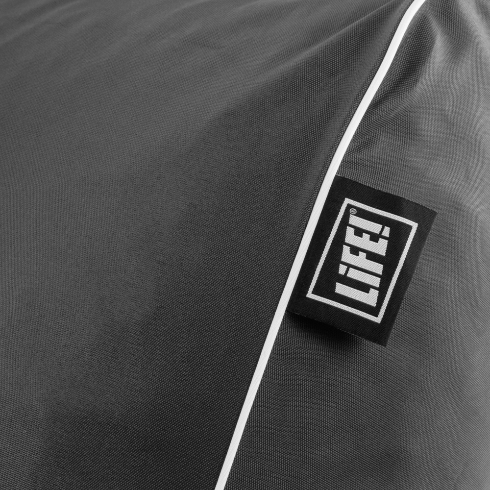 Close up of the life! logo on the tag of a stone grey coastal lounger bean bag showing the contrast white trim
