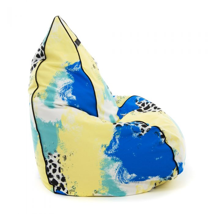 Side view of tear drop shaped bean bag in bold abstract hand drawn designer tier fabric in green, blue, yellow and white with black splotches.