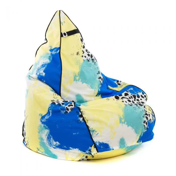 Tear drop shaped bean bag in bold abstract hand drawn designer tier fabric in green, blue, yellow and white with black splotches.