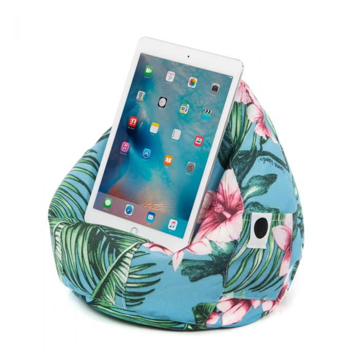 A tablet rests on the tropical print Belvedere bean caddy ipad cushion book rest iphone holder