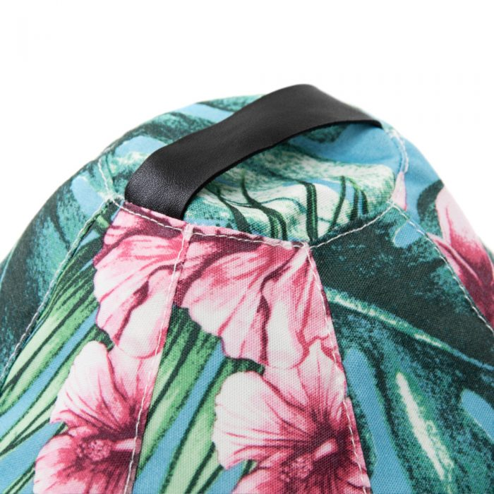 Close up of the carry handle on the Belvedere tropical print iCrib bean caddy ipad holder book rest tablet cushion