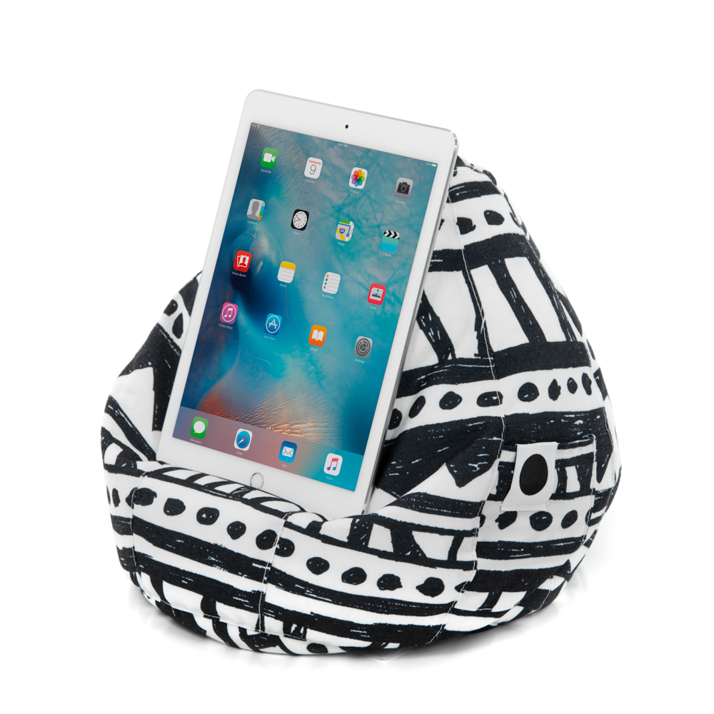A tablet rests on the bermuda icrib bean caddy ipad cushion book holder