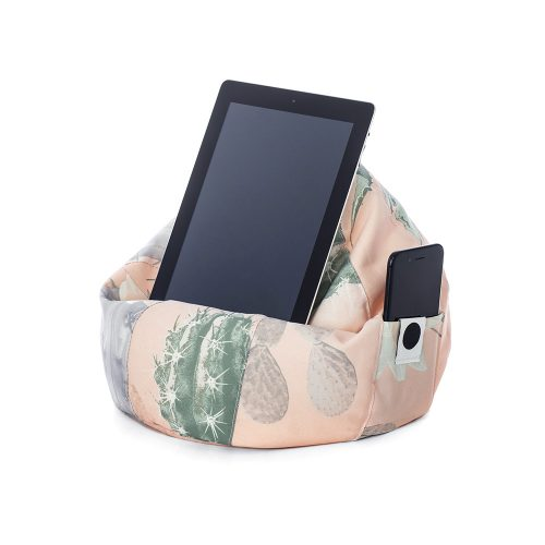 A tablet is resting in the pink and green kakteen print icrib bean caddy iPad holder with a mobile device in the storage pocket.