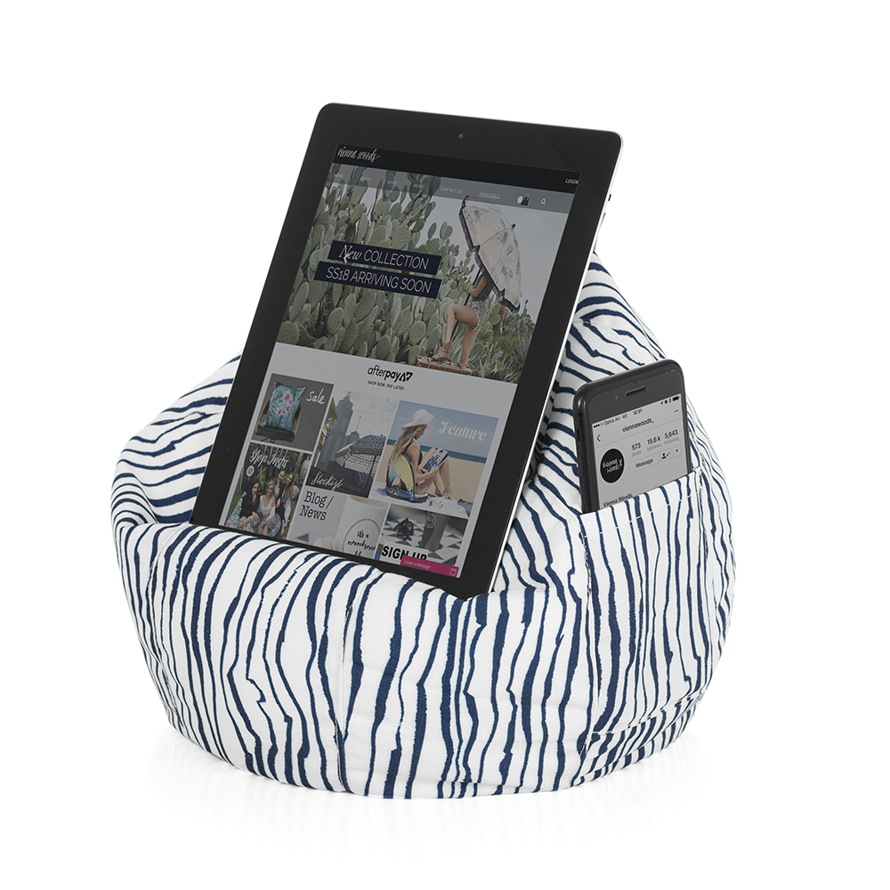 Blue and white marine print iCrib bean caddy shown holding a table and with a mobile phone in the storage pocket