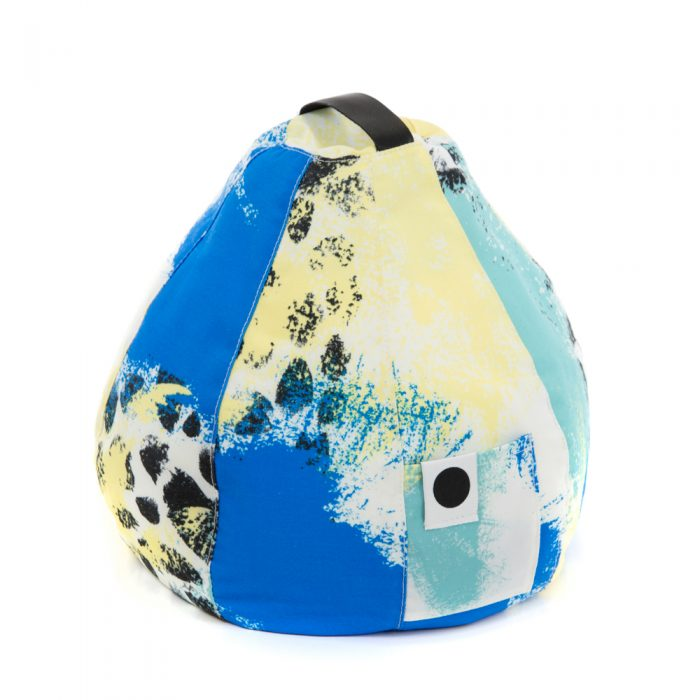 The bright contemporary tier print with yellow, blue and green. Image shows the carry handle and storage pocket.