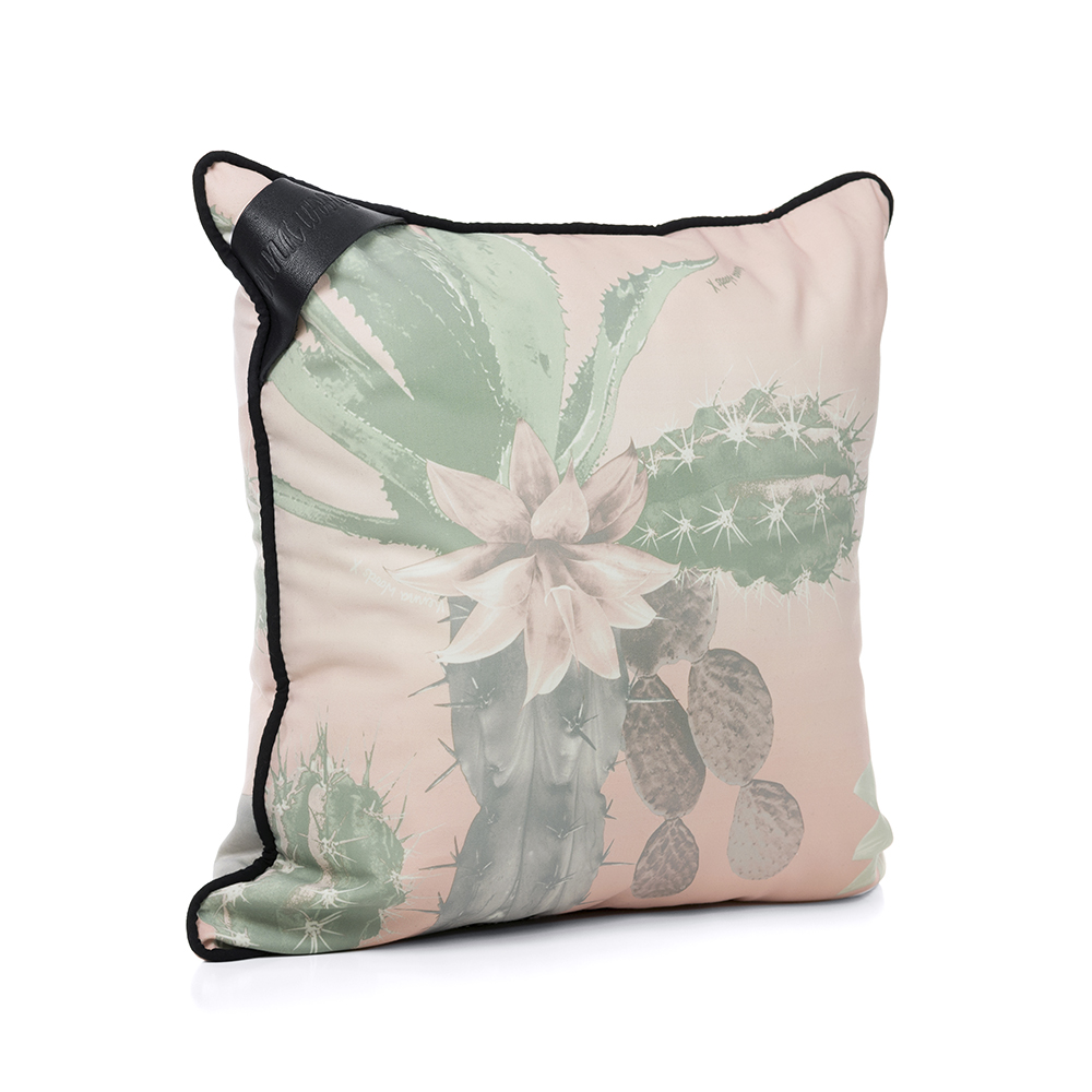 Oblique view of the hand drawn designer kakteen print indoor outdoor cushion featuring large scale cactus in a pale soft green and pink color