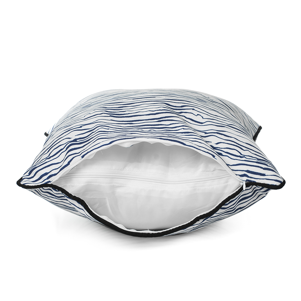 Side view of the blue wave print marine indoor outdoor cushion showing the cover and liner zippers and the black trim