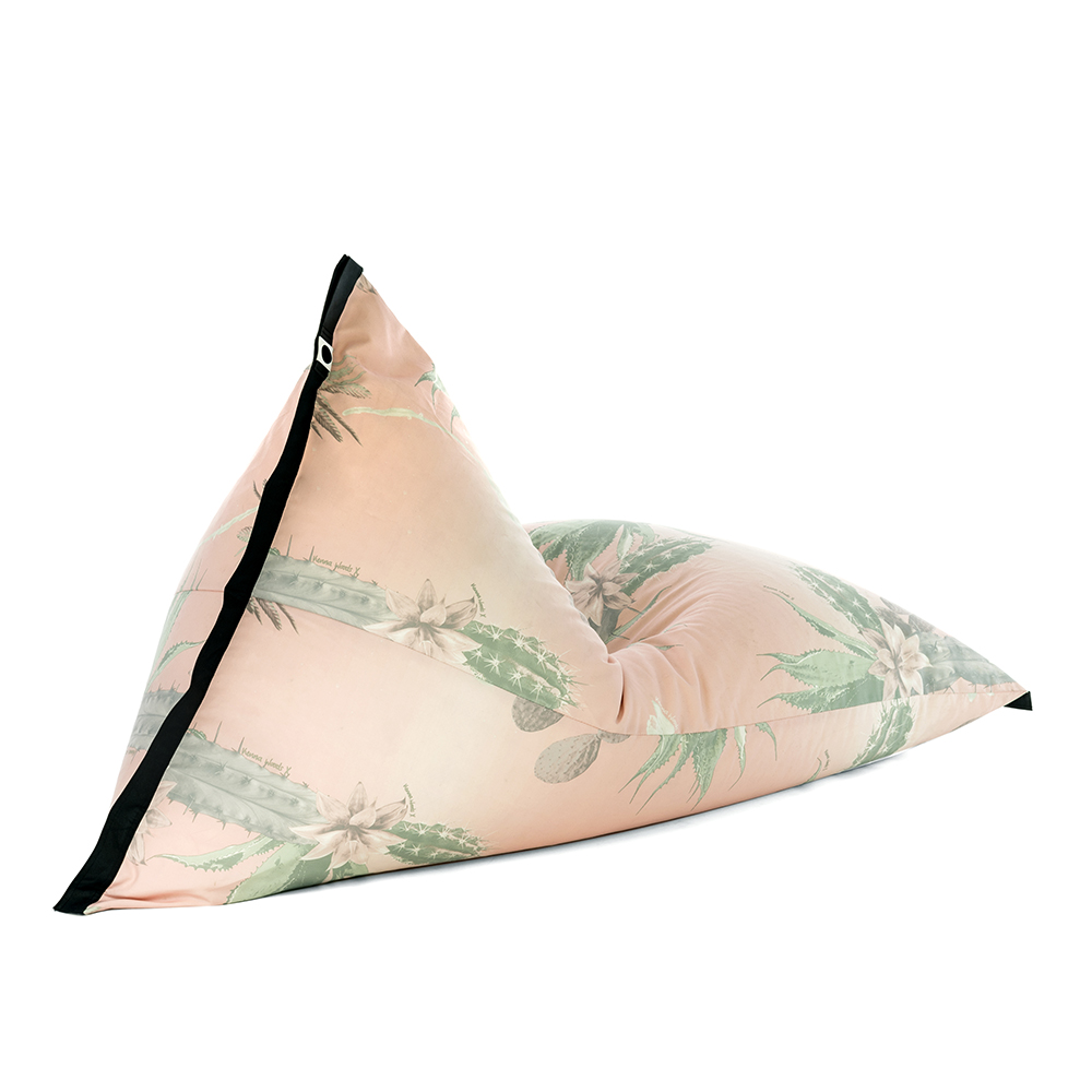 Oblique view of lifestyle tetrahedral shaped bean bag in pink and green cactus print Kakteen material with black contrast trim