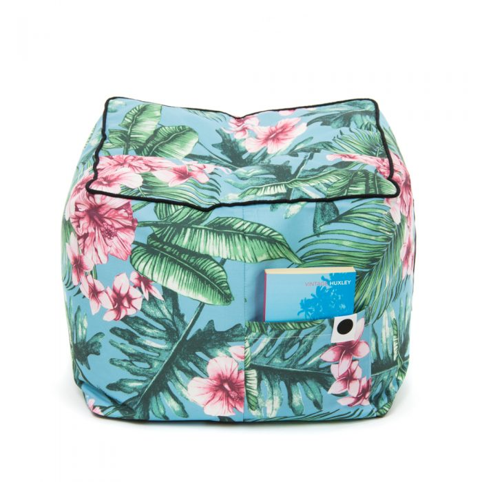 Tropical print belvedere ottoman showing the storage pocket and carry handle and black contrast trim.