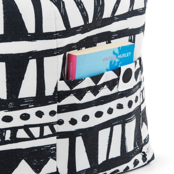 Close up of the storage pocket on the black and white print Bermuda ottoman