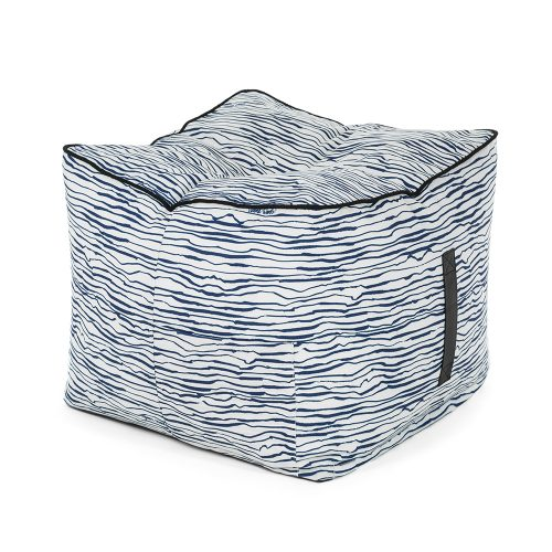 Oblique view of the blue wave print marine ottoman showing the carry handle and storage pocket.