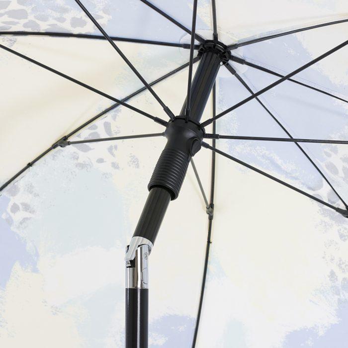 Close up of the black hardware and chrome tilt sun umbrella mechanism
