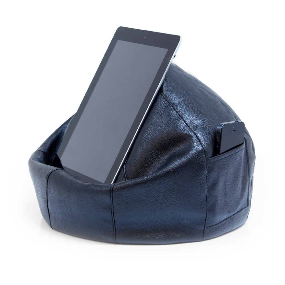 A tablet rests on a black faux leather iCrib iPad holder with a phone in the storage pocket