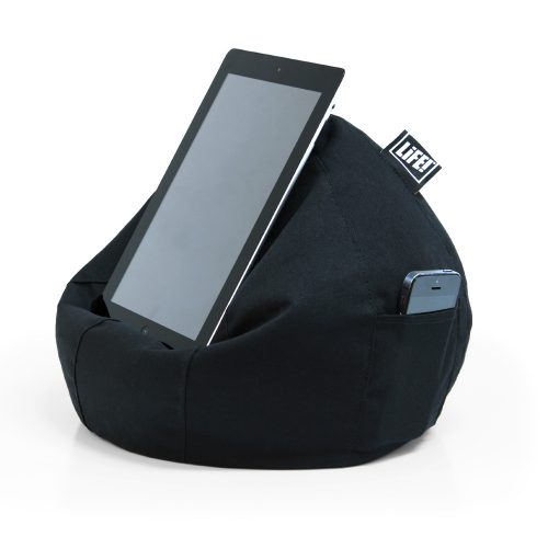 An tablet iPAd sits on a black icrib tablet holder iPad bean bag with a smart phone in the storage pocket