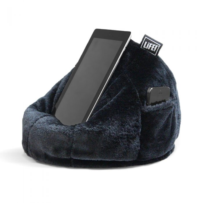 An ipad sits on the black faux fur iCrib tablet holder bean bag with a iPhone visible in the storage pocket