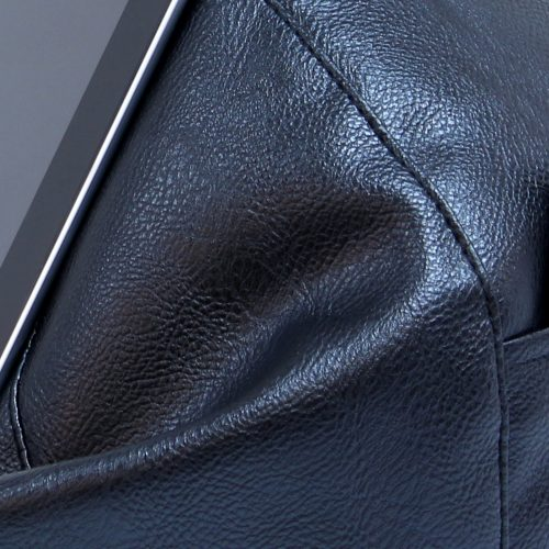 Close up of the black faux leather material used in the iCrib tablet holder iPad bean bag