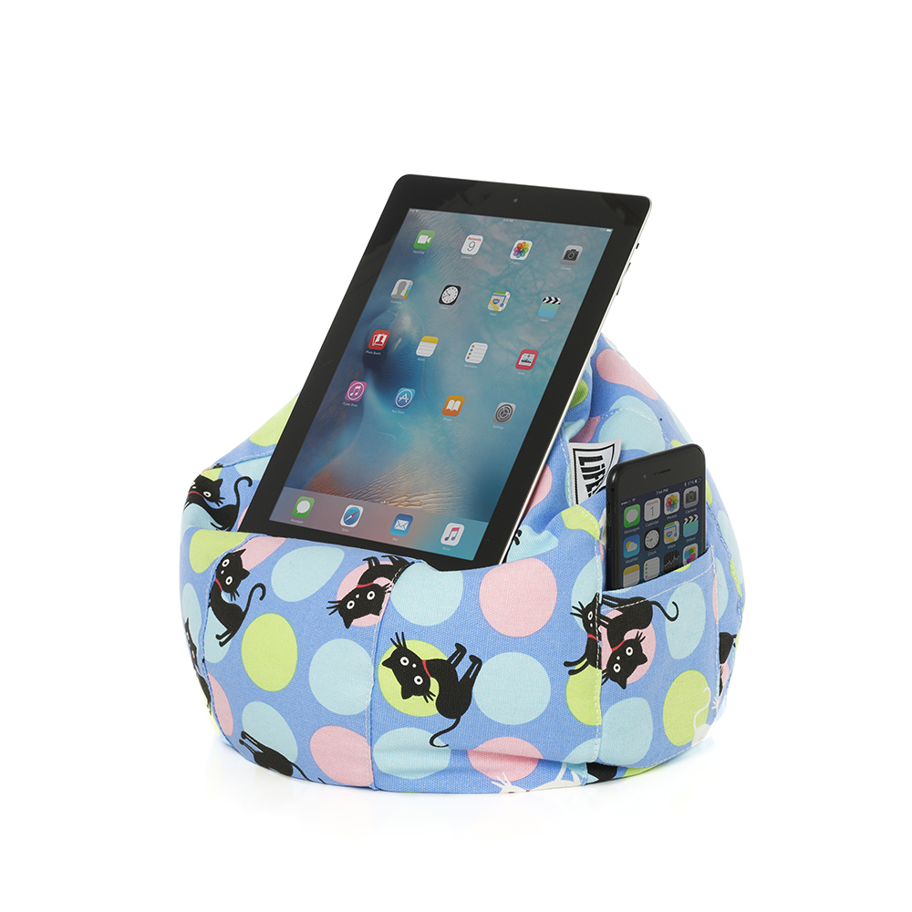 Light blue iCrib bean bag with pastel spots and black and white cat print. An iPad or tablet is held in the device for hands free use and a mobile phone or iPhone sits in the storage pocket