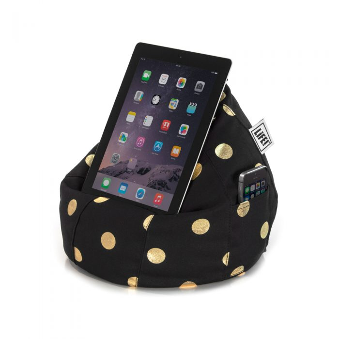 Black iCrib with metallic gold coin print with an ipad sitting on the tablet holder bean bag and a mobile phone iPhone in the storage pocket