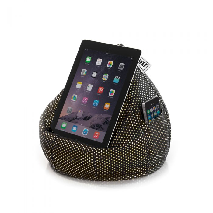An iPad tablet smart device rests on a black iCrib book rest with small metallic gold dot print