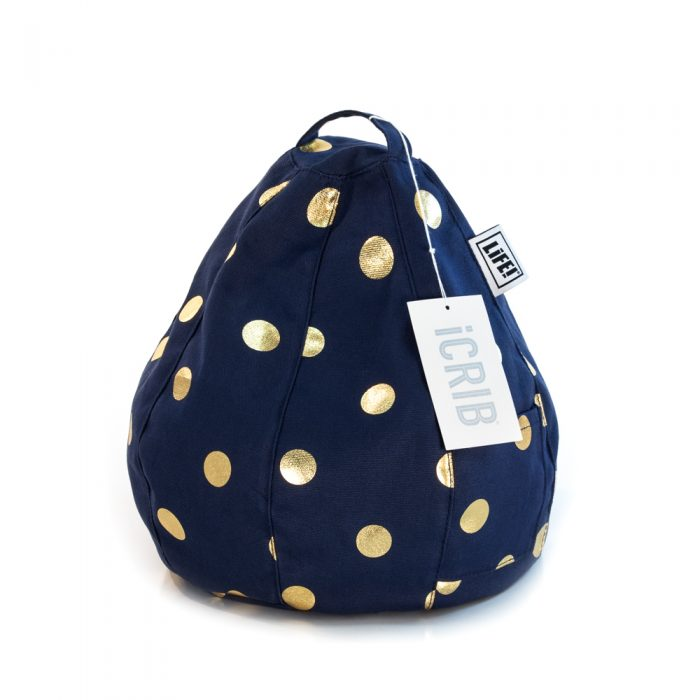 A dark blue iCrib tablet holder book rest iPad bean bag with metallic gold coin spots. The iCrib tag is visible.