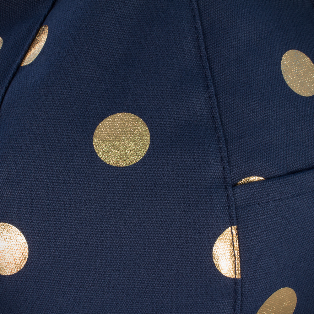 Close up of the dark blue iCrib fabric with the metallic gold coin spot dot print