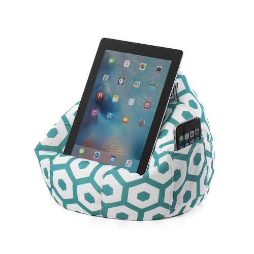A tablet or portable device sits on a white iCrib with mint green geometric print. A smart phone mobile device sits in the storage pocket