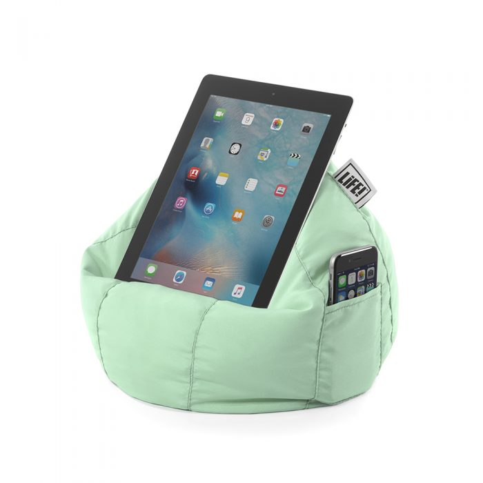 A tablet sits securely on a iPad bean bag cushion stand holder iCrib with a phone in the storage pocket