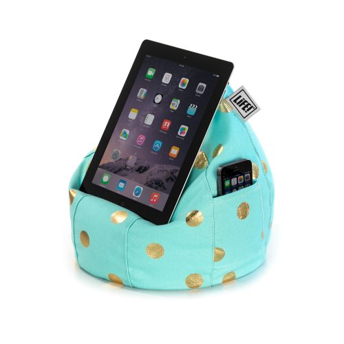 A tablet, iPad or mobile device sits securely on the iCrib tablet holder book rest iPad stand. Its powder blue turquoise with metallic gold coin spots