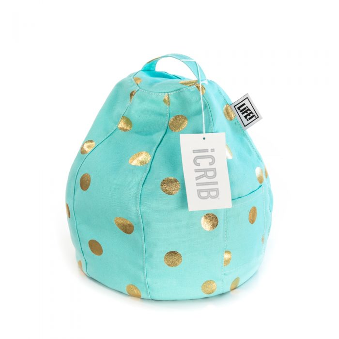 A turquoise powder blue iCrib with handle and storage pocket, and metallic gold coin print. The iCrib tag is visible