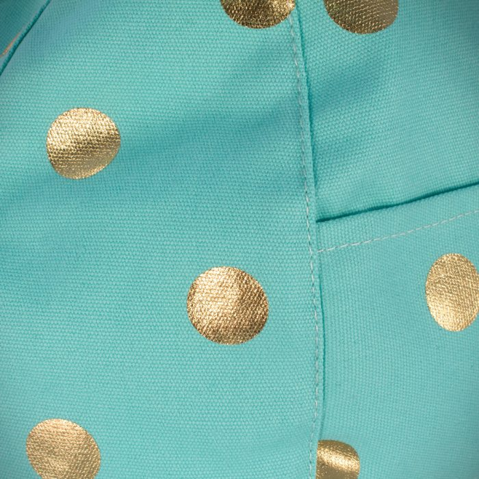 Close up of the turquoise powder blue fabric with large metallic dot gold coin print