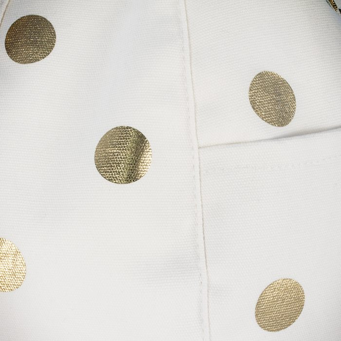 Close up of the white material and metallic gold coin spot dot coin print on the white gold coin iCrib