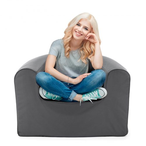 Women sits in a castle rock grey pop lounge foam armchair