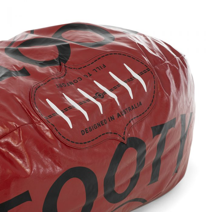 Close up of the lace detail on the large dark red football shaped bean bag