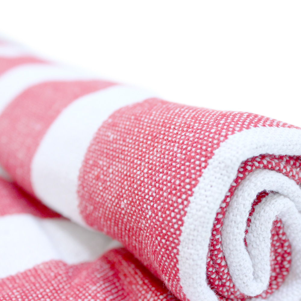 Close up of the red and white striped beach mat picnic rug beach towel