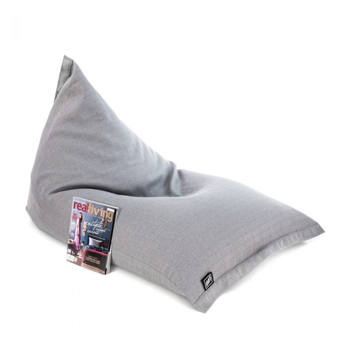 Oblique view of the grey linen look sunny boy bean bag with a magazine leaning against it