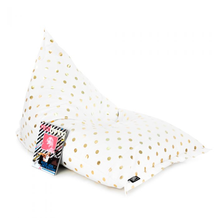 Oblique view of white sunny boy bean bag with gold spot dot print and a magazine resting against it