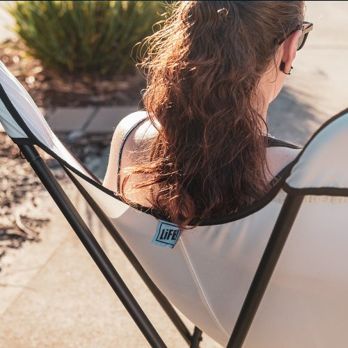 Close up of the back of the white butterfly outdoor chair with black trim showing the Life! logo on the tag