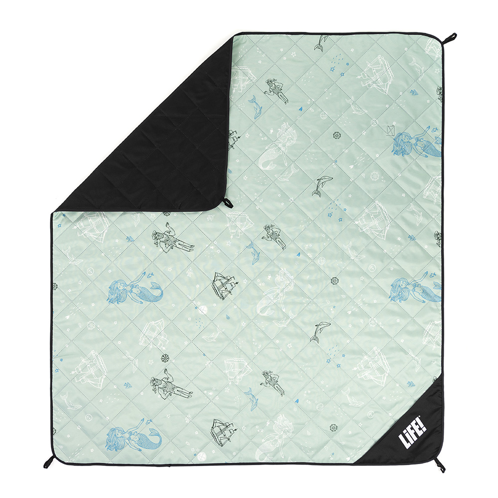 Sea of love adventure mat from above showing hanging loops, privacy pocket and nautical print