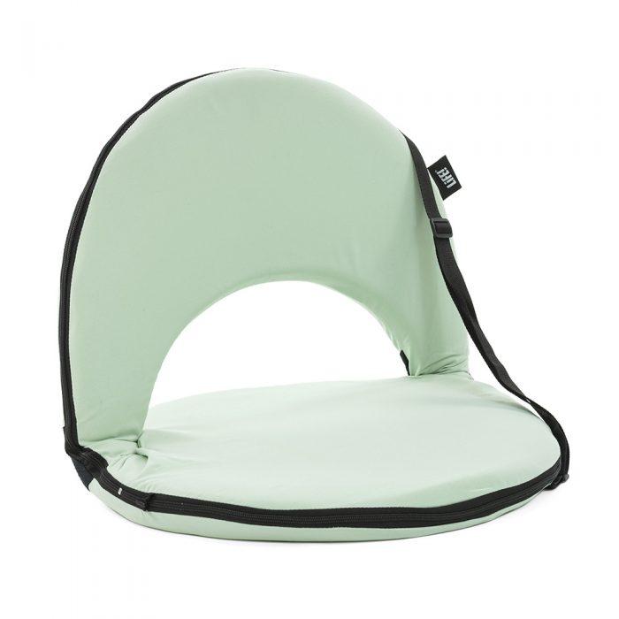 Oblique view of the tropical green cushion recliner beach chair