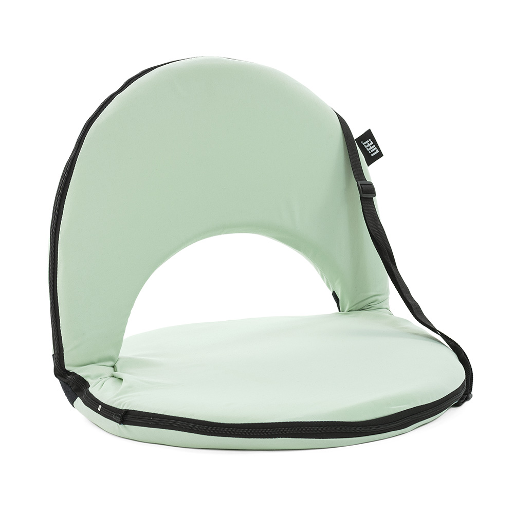 Oblique view of the tropical green cushion recliner beach chair
