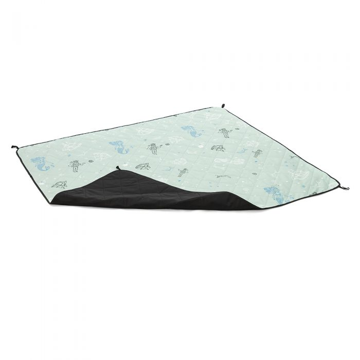 Oblique view of the sea of love adventure mat showing underside on an overturned corner. Soft green base with mermaid, sailor, dophin and ship print