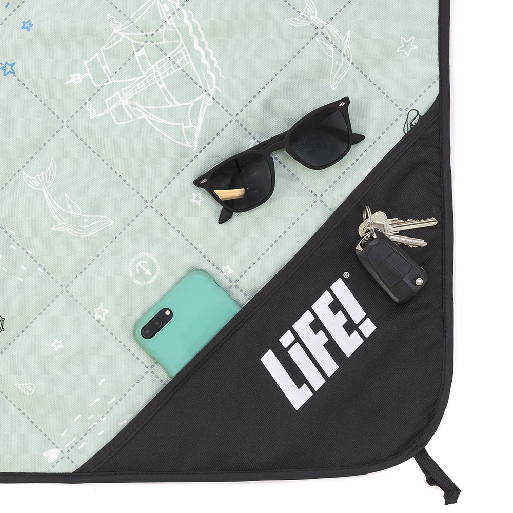 Close up of the privacy storage pocket on the sea of love adventure mat picnic rug