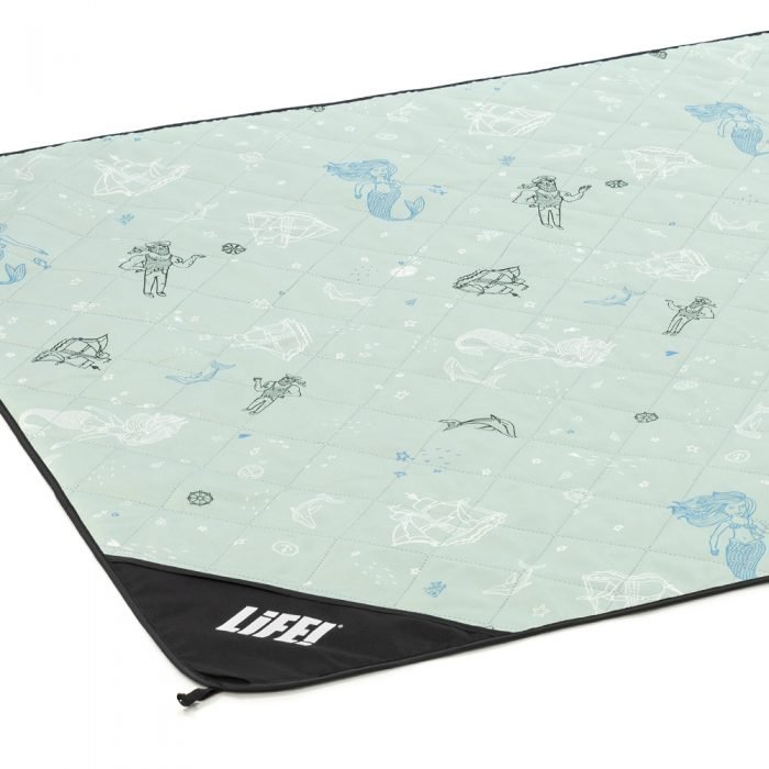 Oblique view of the sea of love adventure mat. Soft green base with mermaid, sailor, dophin and ship print