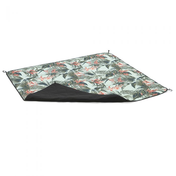 Oblique view of waikiki print adventure mat picnic blanket with corner turned over to show the other side