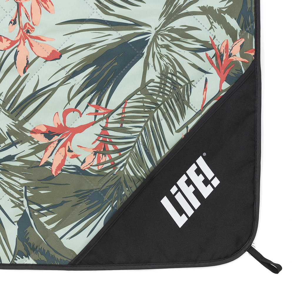 Close up of the LiFE! logo on the waikiki print adventure mat picnic rug