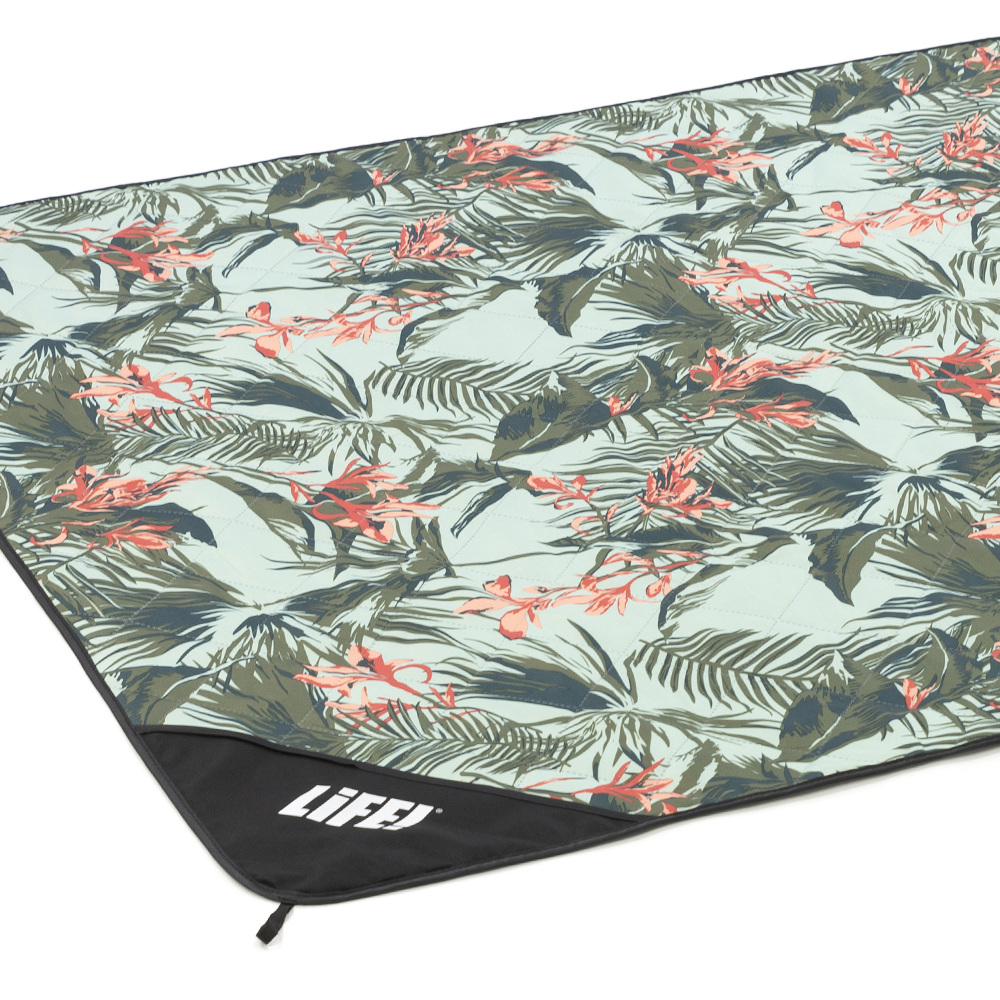 Oblique view of waikiki tropical print adventure mat picnic blanket